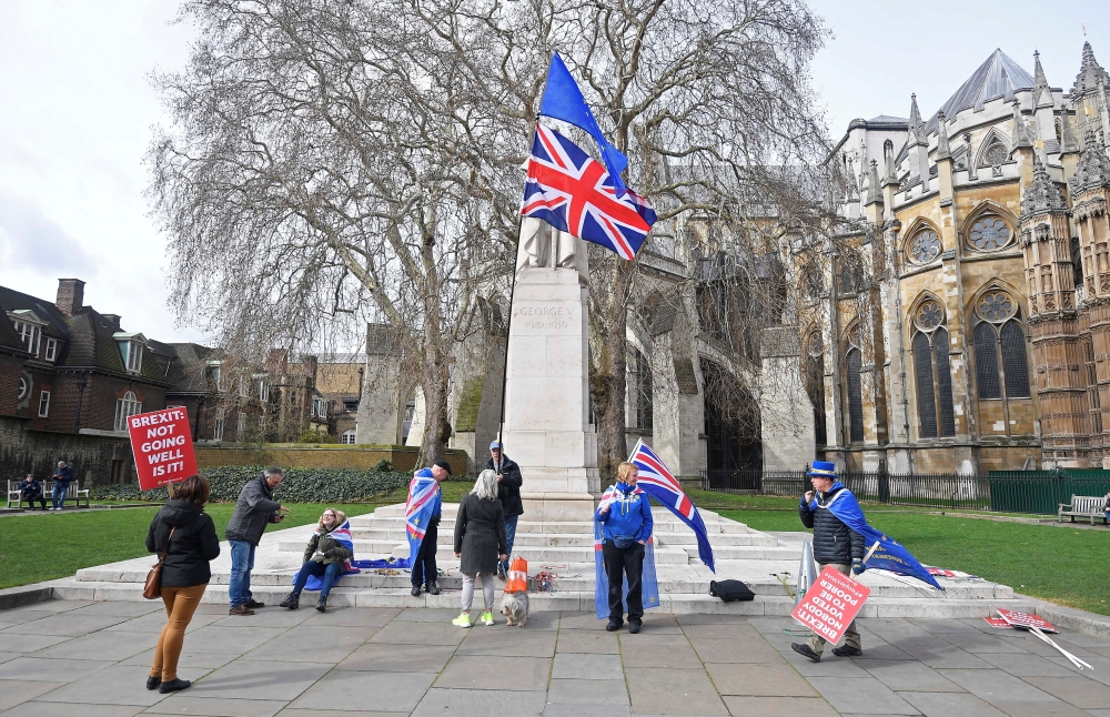 Anti-Brexit protesters gather opposite the Houses of Parliament in London on Monday. — Reuters