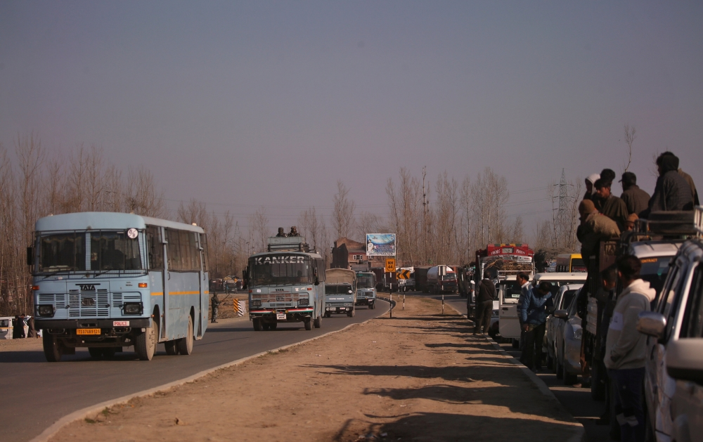 Traffic is stopped as the Indian Central Reserve Police Force (CRPF) convoy moves along a national highway in Qazigund, Indian-administered Kashmir, on Monday. — Reuters