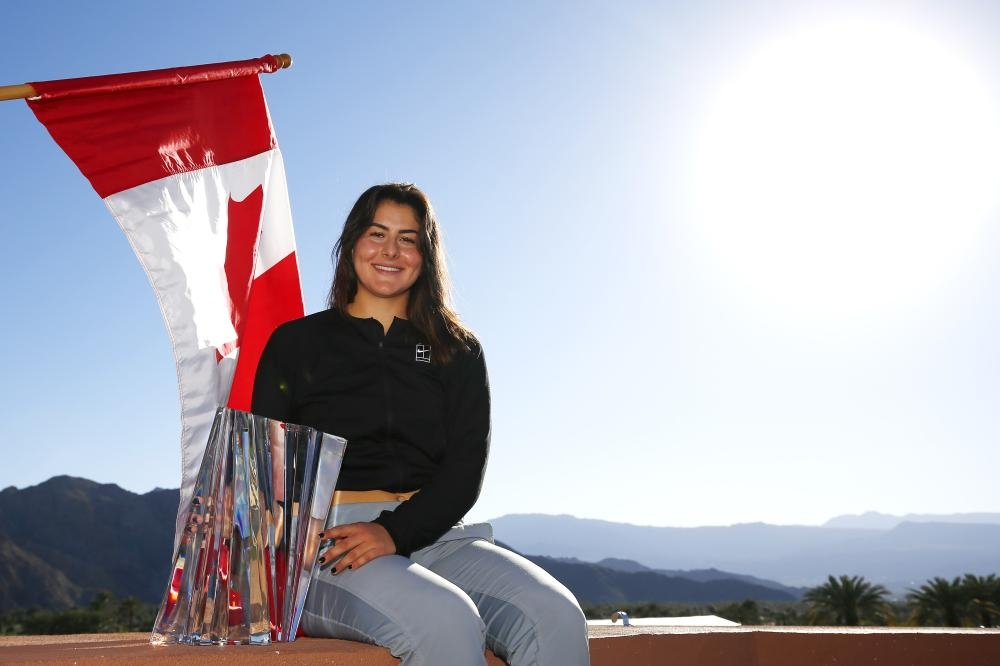 Bianca Andreescu poses with the Indian Wells Trophy. — AFP