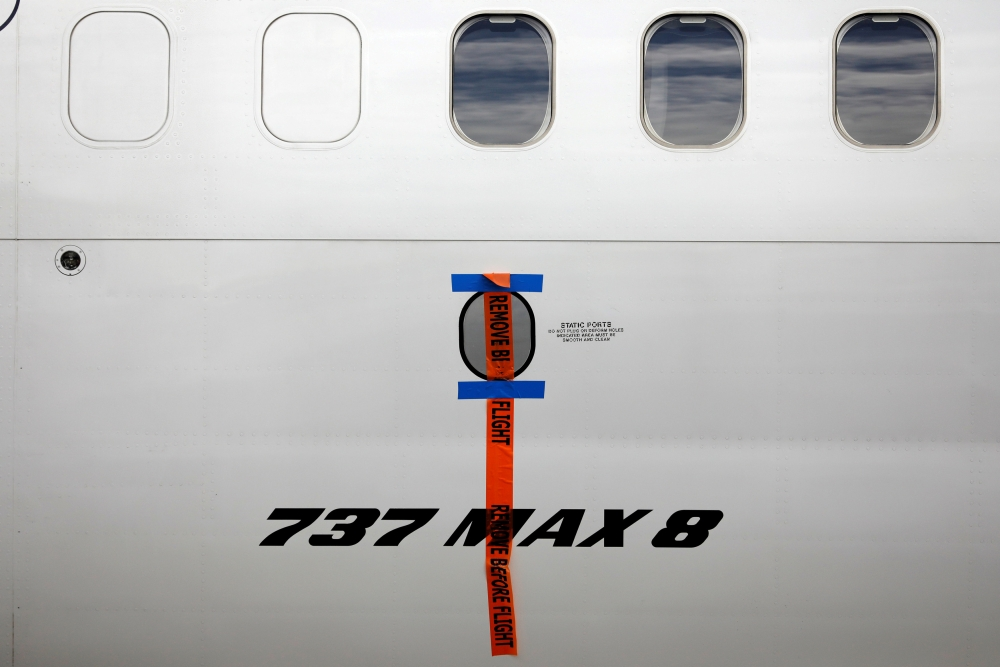 A seal is seen on Garuda Indonesia's Boeing 737 Max 8 airplane parked at the Garuda Maintenance Facility AeroAsia, at Soekarno-Hatta International airport near Jakarta, Indonesia, in this March 13, 2019 file photo. — Reuters