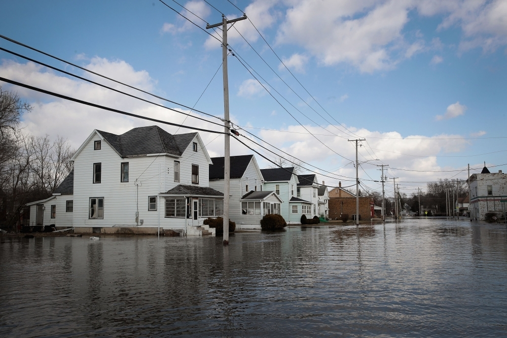 Homes are surrounded by floodwater from the Pecatonica River in Freeport, Illinois, on Monday. — AFP