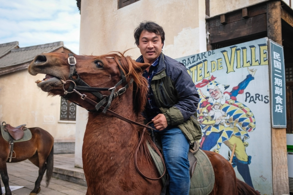 Stunt horse rider Lian Chunyu from Inner Mongolia. — AFP