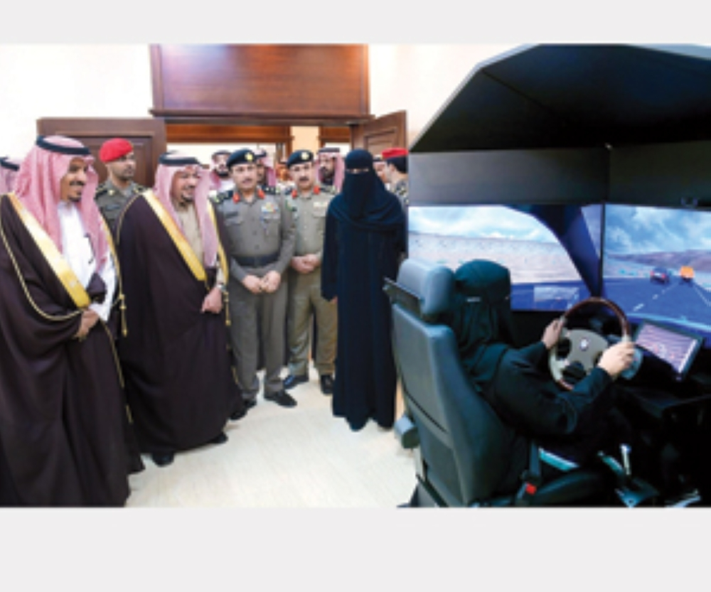 Emir of Qassim Prince Faisal Bin Mishaal and Director General of Traffic Maj. Gen. Mohammed Al-Bassami watch as a woman trains at the newly launched driving school at Qassim University.
