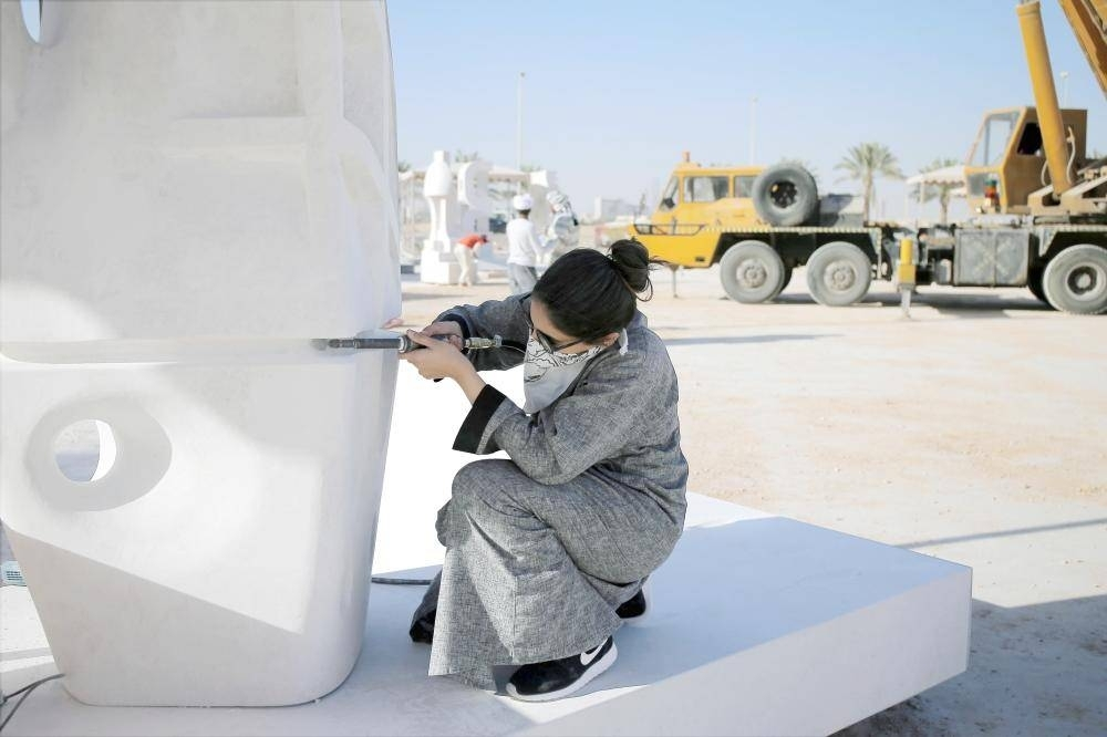 Dalia Al-Mandeel giving final touches to her work of art.