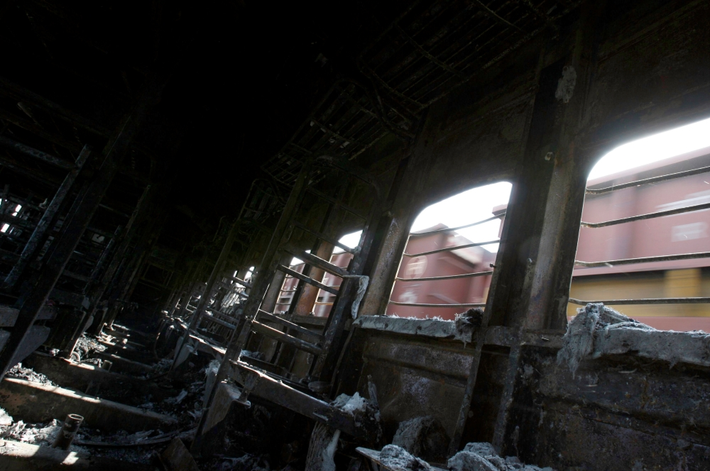 A view of a burned carriage of Samjhauta Express train in Deewana, near Panipat town, in this Feb.19, 2007 file photo. — Reuters
