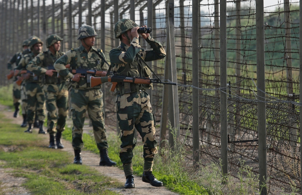 Indian Border Security Force soldiers patrol along the fenced border with Pakistan in the Ranbir Singh Pura sector near Jammu in this Feb. 26, 2019 file photo. — Reuters