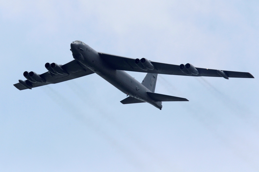 A Boeing B-52 bomber from the US Air Force Andersen Air Force Base in Guam performs a fly-over at the Singapore Airshow in Singapore in this Feb. 14, 2012 file photo. — Reuters