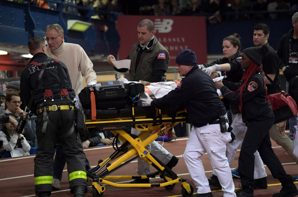 File photo sows Kemoy Campbell (JAM) being taken off the track on a stretcher after collapsing in the 3,000m during the 112th Millrose Games at The Armory. — Reuters