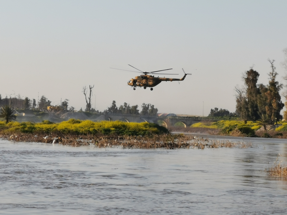 An Iraqi rescue helicopter searches for survivors at the site where an overloaded ferry sank in the Tigris river near Mosul in Iraq on Thursday. — Reuters