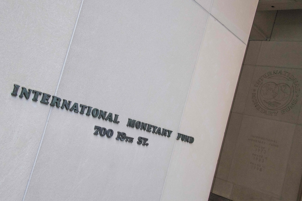 In this file photo, the International Monetary Fund (IMF) is seen in Washington, DC.  The IMF on Thursday, said the US economic outlook remained