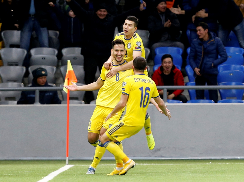 Kazakhstan's Yuriy Pertsukh celebrates scoring their first goal with teammates against Scotland in the Euro 2020 Qualifier Group I clash at the Astana Arena, Astana, Kazakhstan. — Reuters