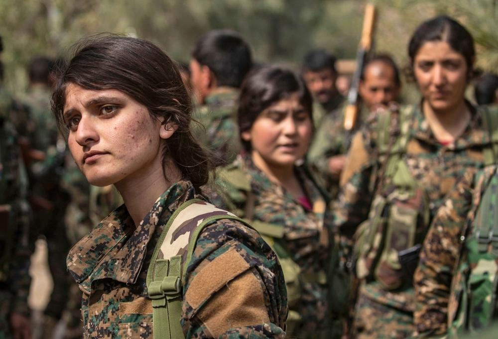 Fighters of the US-backed Kurdish-led Syrian Democratic Forces (SDF) gather to celebrate near the Omar Oil Field in the eastern Syrian Deir Ez-Zor province on Saturday, after announcing the total elimination of Daesh (the so-called IS) group's last bastion in eastern Syria. — AFP
