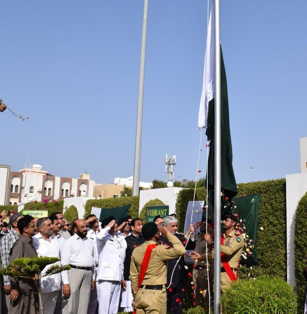 Consul General Shehryar Akbar Khan raises Pakistan's national flag in Jeddah.