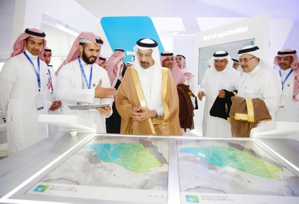 Saudi Energy Minister and Chairman of Saudi Aramco Khalid Al-Falih and Minister of Commerce and Investment Dr Majid bin Abdullah Al Qasabi look at the economic development map as concerned official explain the plan