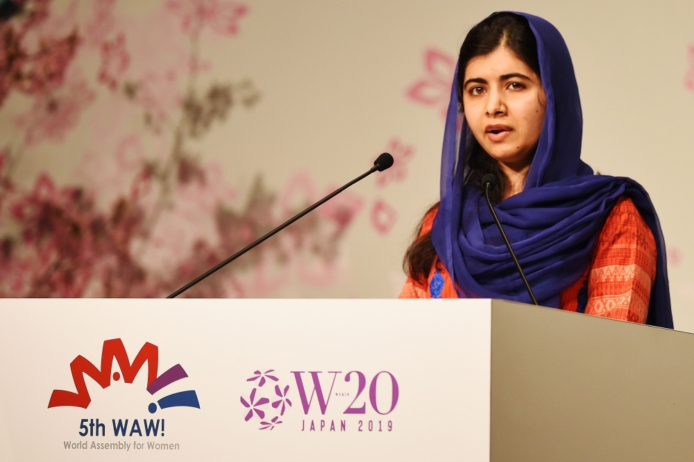 Nobel Peace Prize laureate Malala Yousafzai delivers a speech during the World Assembly for Women (WAW) in Tokyo on Friday. — AFP