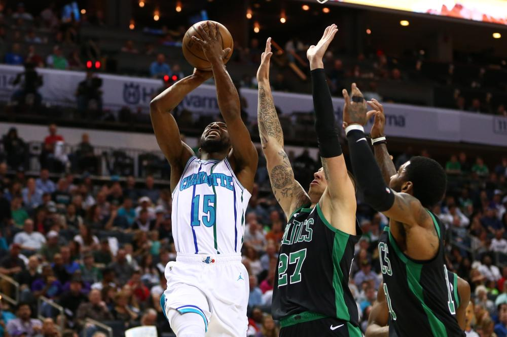 Charlotte Hornets' guard Kemba Walker shoots the ball against Boston Celtics during their NBA game at Spectrum Center in Charlotte Saturday. — Reuters