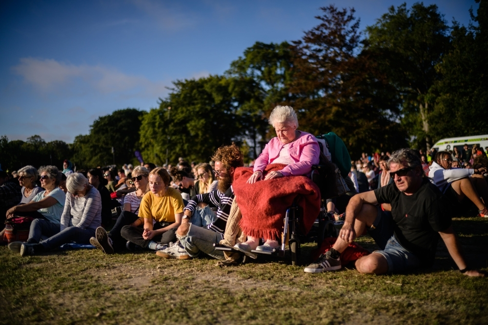 People on Sunday attend a vigil in memory of the twin mosque massacre victims in Christchurch. New Zealand will hold a national remembrance service for victims of the Christchurch massacre on March 29, the government announced, as the country grieves over a tragedy that shocked the world. — AFP