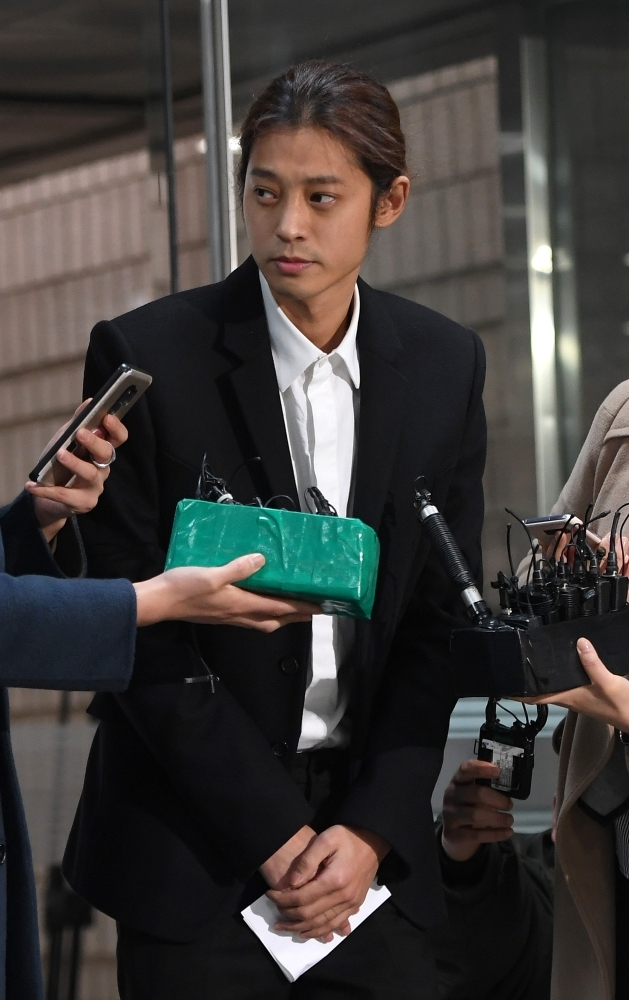 K-pop star Jung Joon-young arrives to attend a hearing on his arrest warrant at the Seoul central district court in Seoul. — AFP