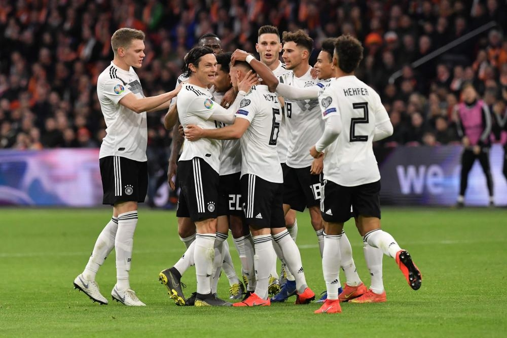 Germany's players celebrate after beating The Netherlands in the UEFA Euro 2020 Group C qualification match at the Johan Cruyff Arena in Amsterdam Sunday. — AFP