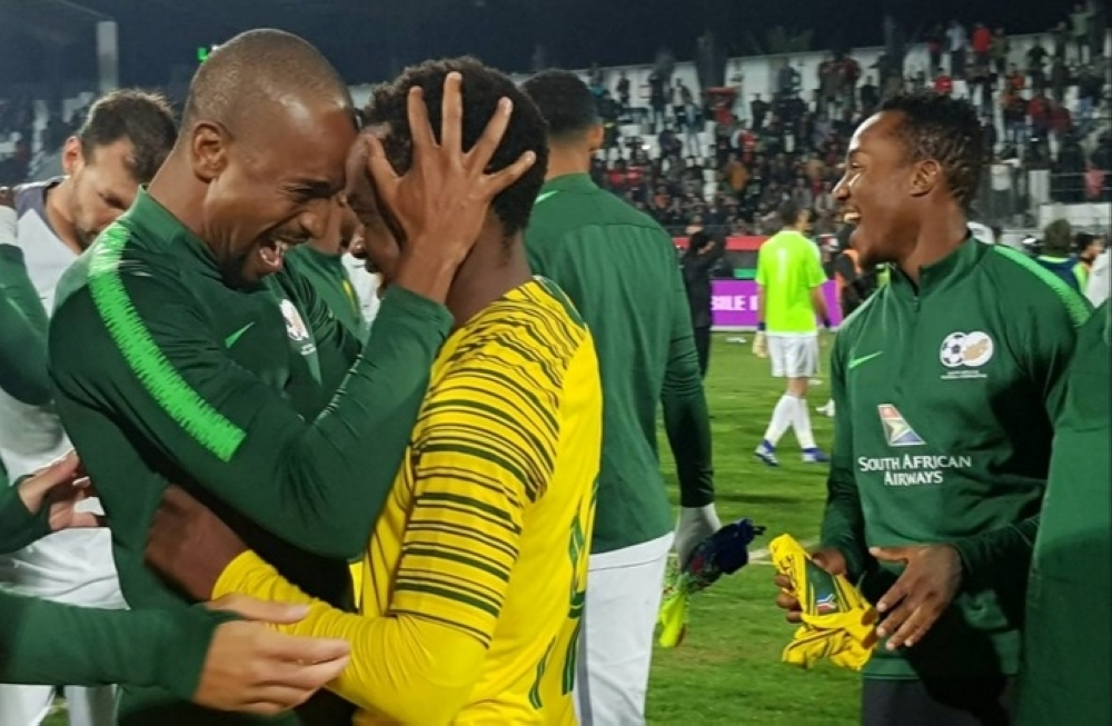 South Africa's players celebrate after they qualified for the African Cup of Nations Finals.