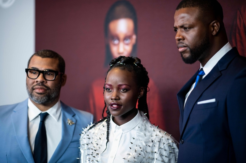 In this file photo taken on Wednesday (R-L) Director/writer Jordan Peele, actress Lupita Nyong'o and actor Winston Duke arrive for the New York premiere of