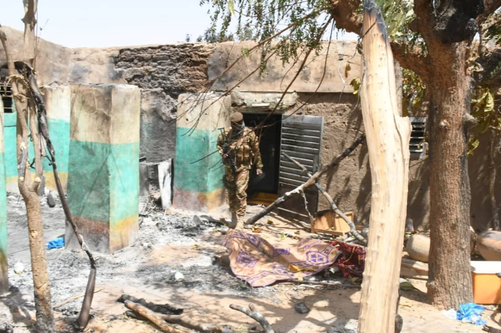 A soldier walks amid the damage after an attack by gunmen on Fulani herders in Ogossagou, Mali, in this March 25, 2019 file photo. — Reuters