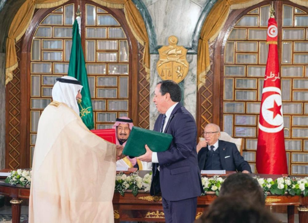 Custodian of the Two Holy Mosques King Salman and Tunisian President Beji Caid Essebsi oversee on Friday the signing of two agreements in Tunisia. — SPA