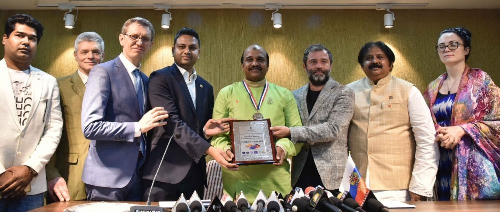 Jaber Patel, center, president of Indo Arab Friendship Forum, receives the BRICS Award at Media Plus Auditorium in Hyderabad, India, last week. — Courtesy photo
