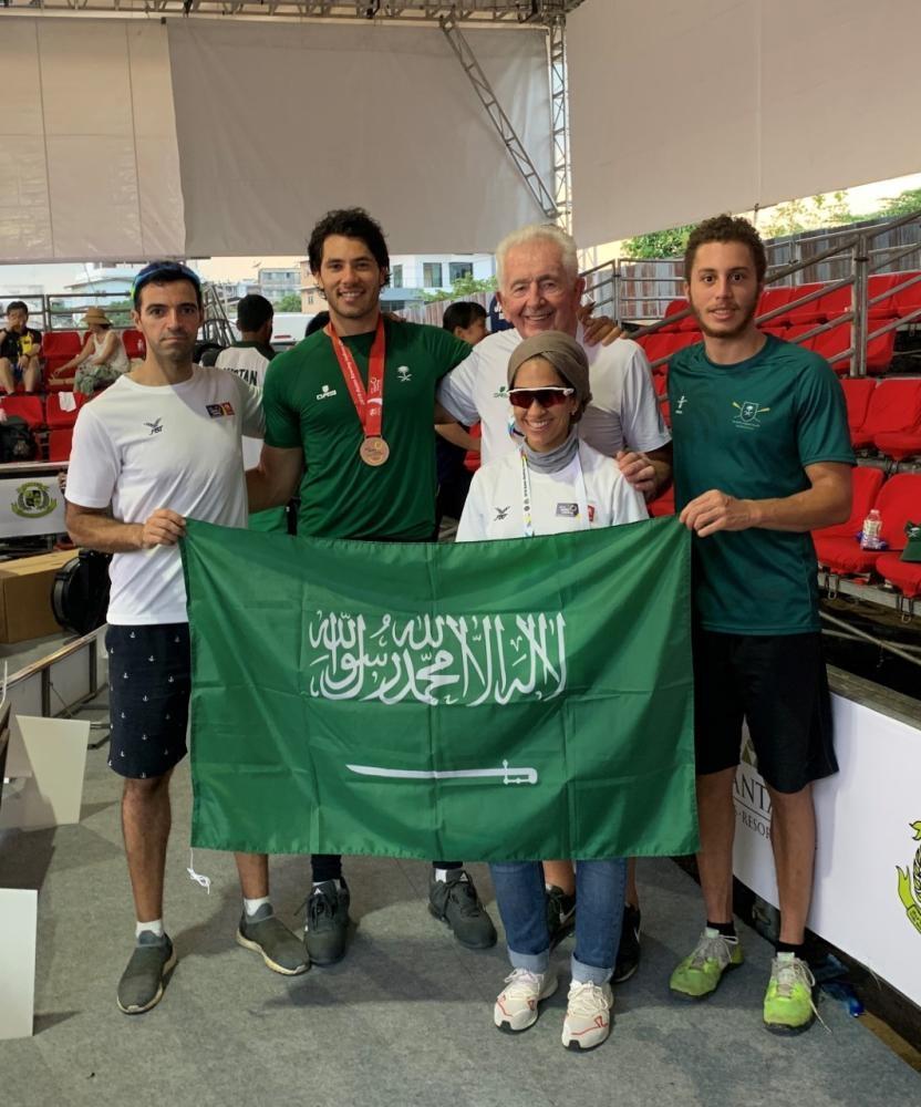 Husein Alireza celebrates with Saudi squad.