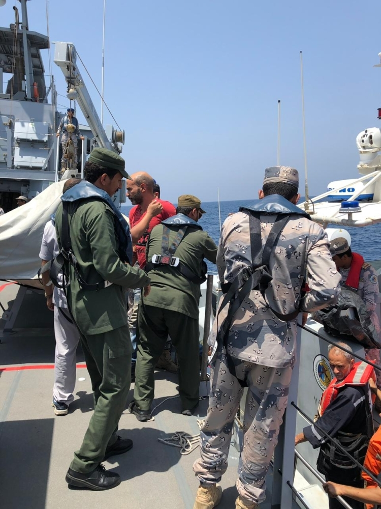 Border Guards lift the distressed sailors from the rescue boat to the Al-Ashiq ship.