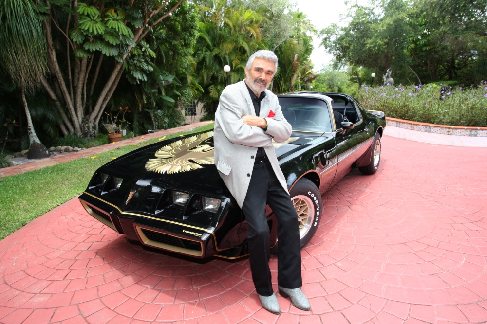 Burt Reynolds stands next to a 1979 Pontiac Trans Am, which was the last Trans Am owned and driven by Reynolds, in this Julien's Auctions photo, released from Culver City, California,. — Reuters