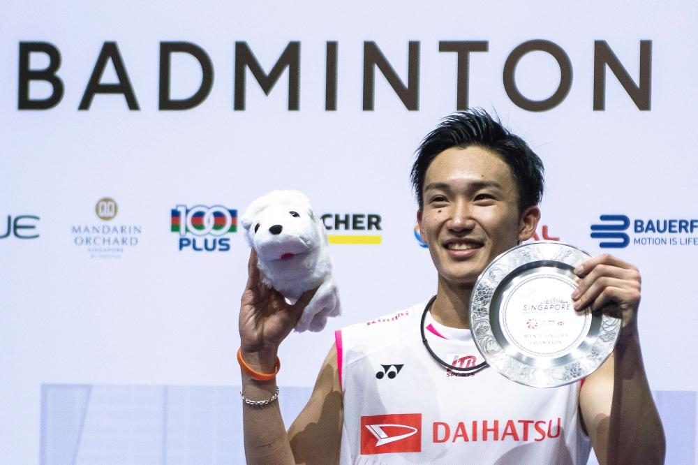 Japan's Kento Momota poses after his final match against Indonesia's Anthony Sinisuka Ginting at the Singapore Open Badminton Tournament in Singapore Sunday. — AFP