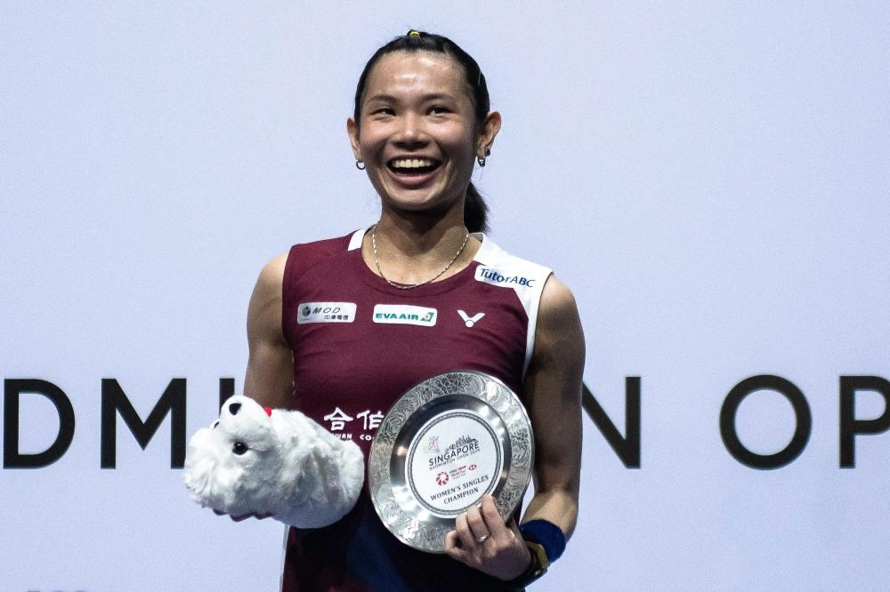 Taiwan's Tai Tzu-ying poses for a photo after winning her final match against Japan's Nozomi Okuhara at the Singapore Open Badminton Tournament in Singapore Sunday. — AFP