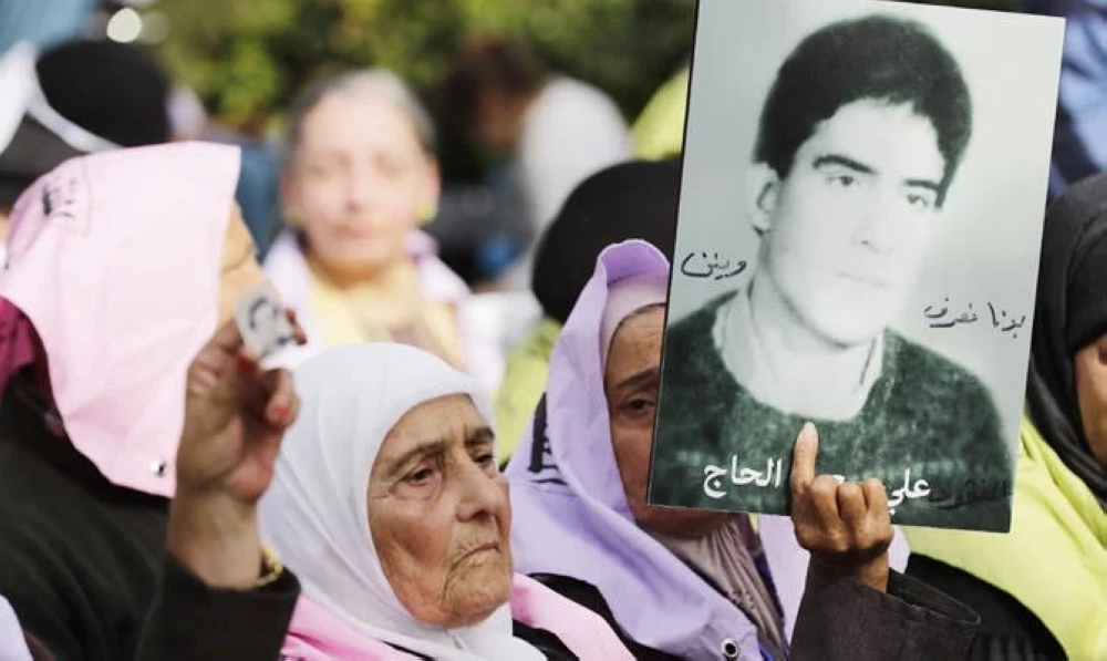 Mothers and relatives of Lebanese citizens who disappeared or went missing since the Lebanese civil war in 1975, carry their pictures during a press conference that revolves around the newly voted law regarding the missing during the civil war, held in Beirut.