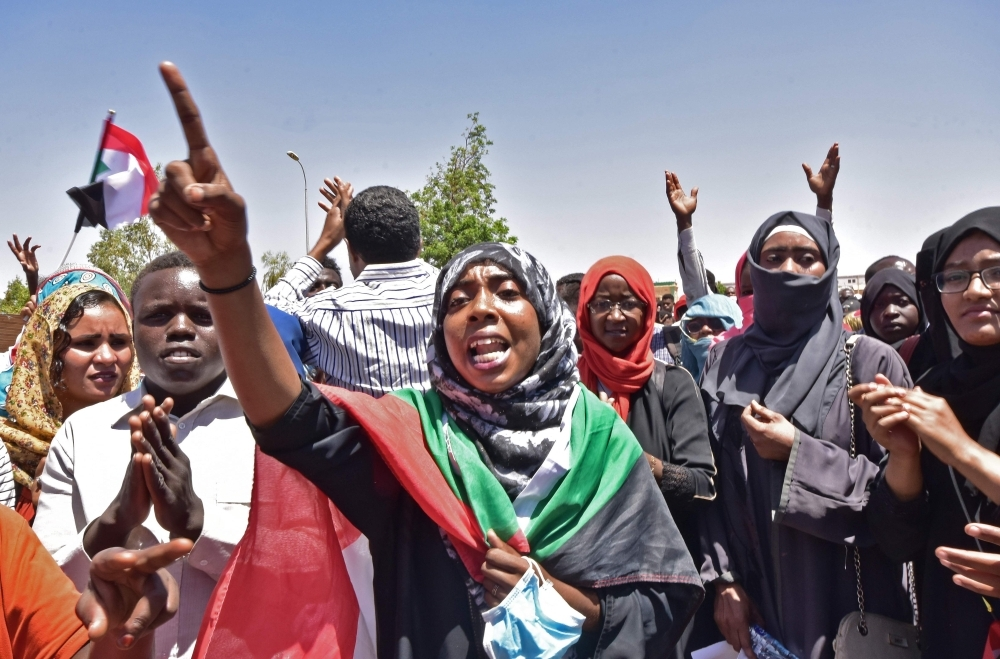 Sudanese demonstrators gather near the military headquarters in the capital Khartoum on Monday. — AFP