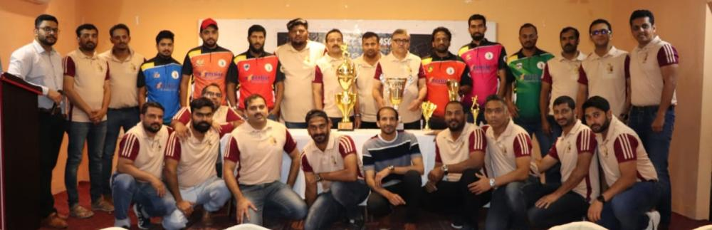 Guests, team captains and TMCC committee members pose after unveiling trophies.