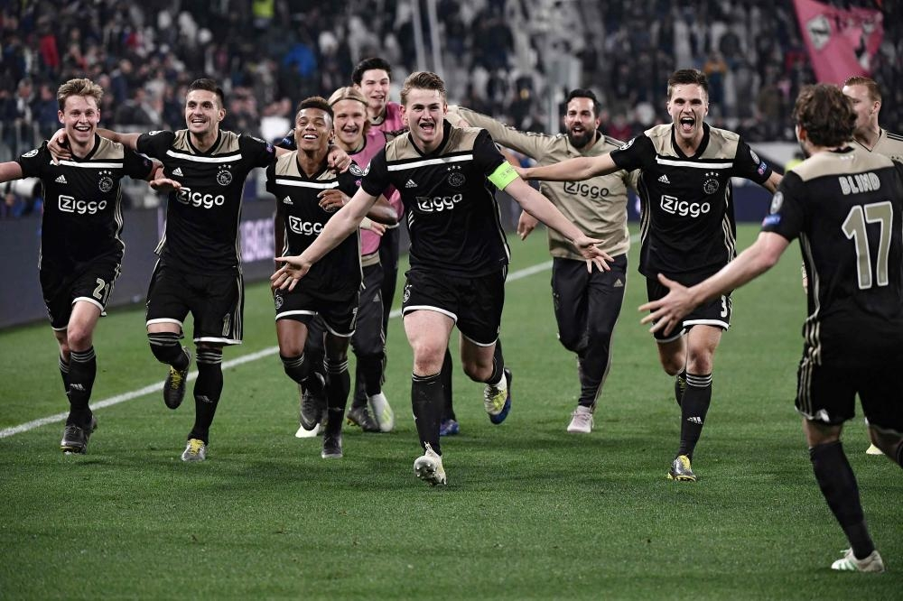 Ajax players celebrate after defeating Juventus during the UEFA Champions League quarterfinal second leg match at the Juventus Stadium in Turin Tuesday. — AFP