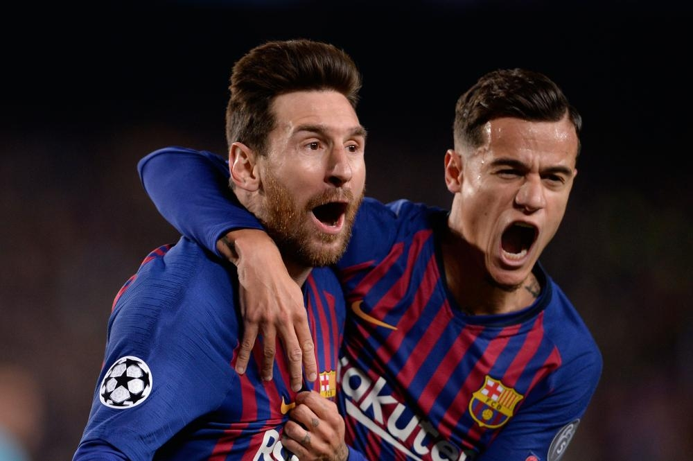 Barcelona's Lionel Messi (L) celebrates with Philippe Coutinho after scoring a goal during the UEFA Champions League quarterfinal second leg match against Manchester United at the Camp Nou Stadium in Barcelona Tuesday. — Reuters
