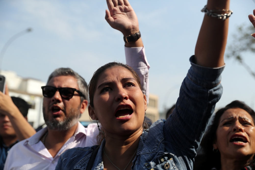 Supporters of Peru's former President Alan Garcia react as they try to enter a hospital where Garcia was taken after he shot himself, in Lima, Peru, on Wednesday. — Reuters