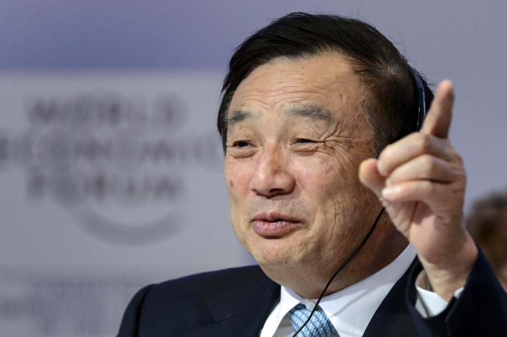 In this file photo, Huawei Founder and CEO Ren Zhengfei gestures as he attends a session of the World Economic Forum (WEF) annual meeting in Davos.  — AFP
