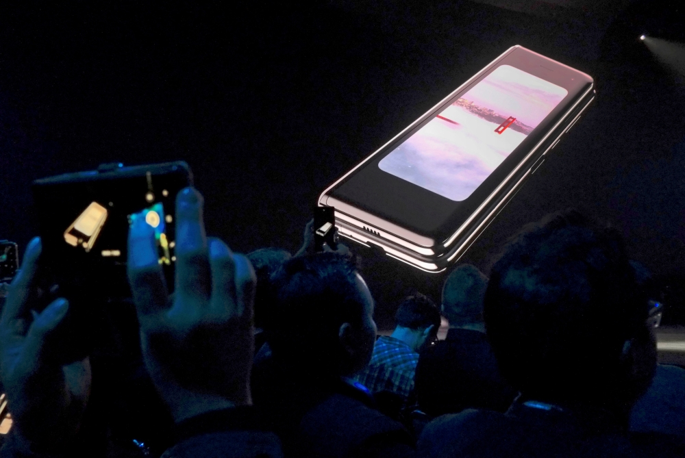 The Samsung Galaxy Fold phone is shown on a screen at Samsung Electronics Co Ltd's Unpacked event in San Francisco, California, US, in this file photo. — Reuters
