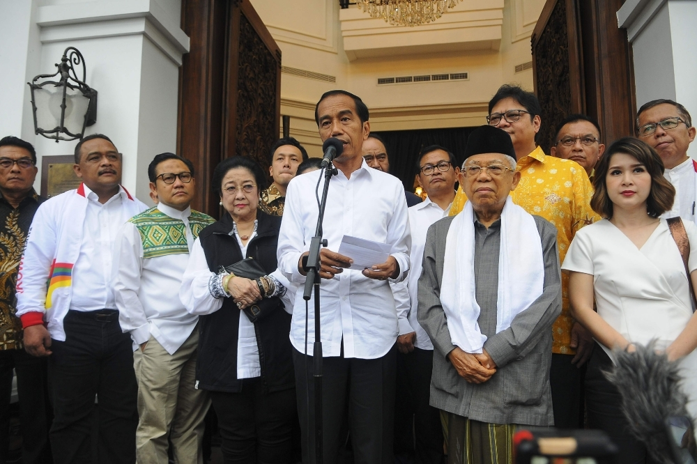 Indonesian President Joko Widodo (center) and his running mate Ma'ruf Amin (centre right) hold a press conference in Jakarta, Thursday. Authorities have warned against unrest as a firebrand ex-general rejected unofficial election results that appeared to hand President Widodo another term as leader of the world's third-biggest democracy. — AFP