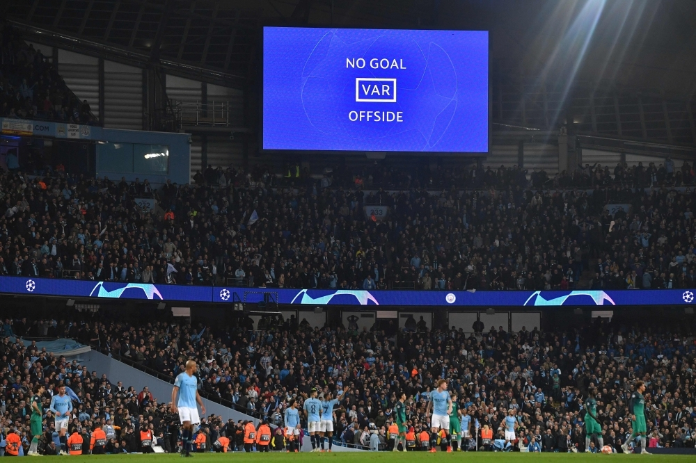 A screen shows the VAR decision announcing that Manchester City's English midfielder Raheem Sterling's goal has been dissallowed in the closing minutes of the UEFA Champions League quarterfinal second leg football match between Manchester City and Tottenham Hotspur at the Etihad Stadium in Manchester, north west England on Wednesday. The match ended 4-4, but Tottenham progress to the semi finals on goal difference. — AFP