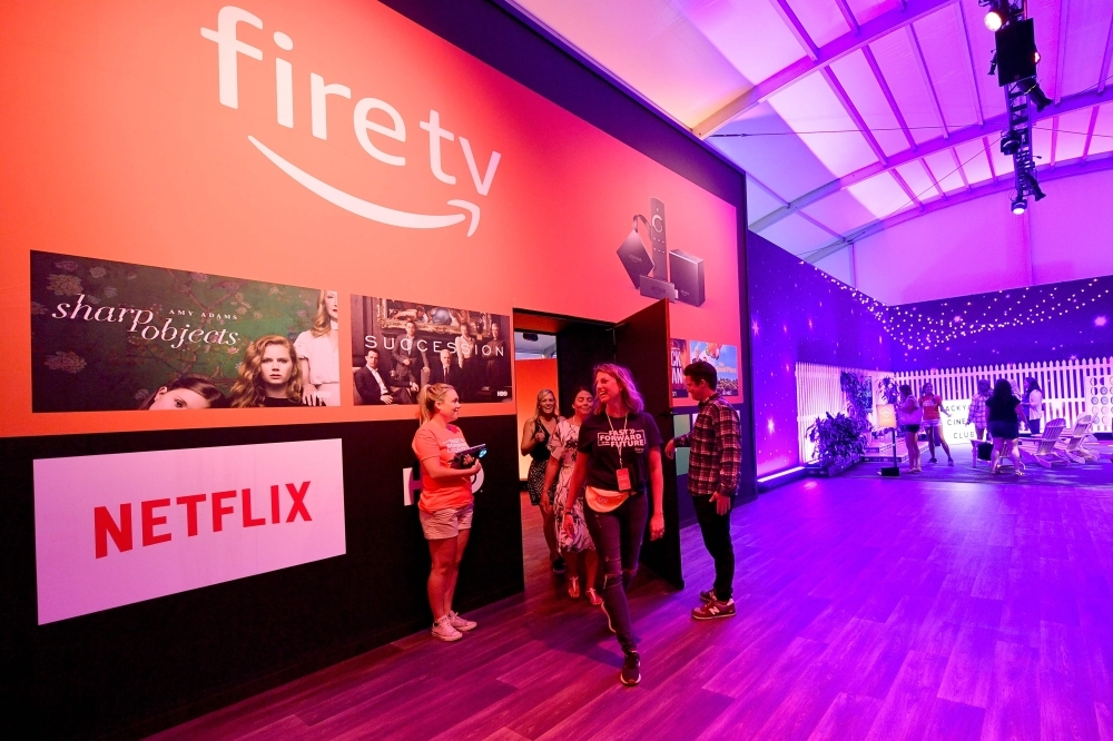 In this file photo guests attend Amazon Fire TV'S 'Fast Forward To The Future' Installation Media Preview during Comic-Con International 2018 in San Diego, California. Amazon and Google announced on Thursday they had agreed to allow each other's streaming media applications to work on their platforms, ending a spat over video between the tech giants. The companies said in a statement that the official YouTube apps will be available on Amazon's Fire TV in the coming months, allowing users of the Amazon platform to access the music videos, movies, shows and other content from the Google-owned service. — AFP