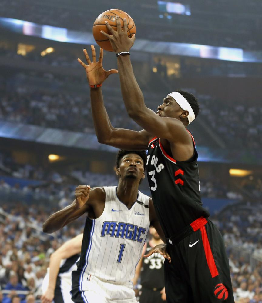 Toronto Raptors' forward Pascal Siakam drives to the basket against Orlando Magic's forward Jonathan Isaac during Game 3 of the first round of the 2019 NBA Playoffs at Amway Center in Orlando Friday. — Reuters
