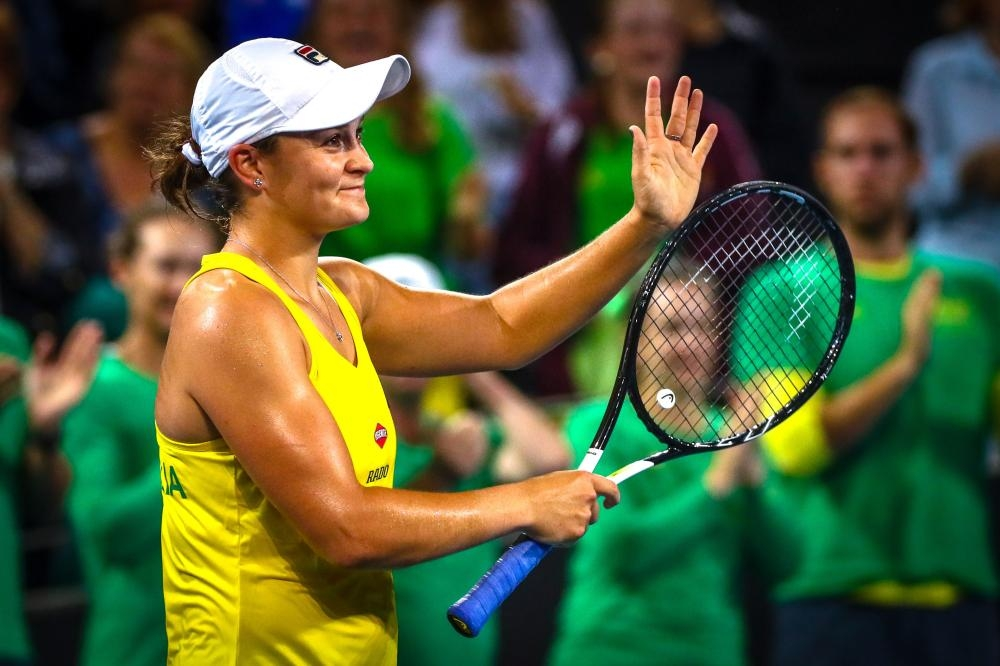 Ashleigh Barty of Australia celebrates her victory over Victoria Azarenka of Belarus during their first round match of the Fed Cup Tennis at the Pat Rafter Arena in Brisbane Saturday. — AFP