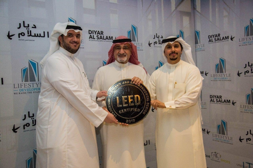 Sheikh Saleh bin Ali Al Turki, Mayor of Jeddah (middle), hands over the Green Building award to Engineer Sultan Subhi Batterjee (right), CEO of Lifestyle Developers