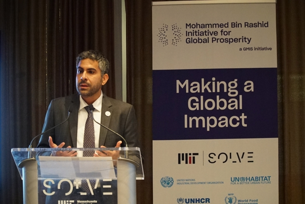 Badr Al-Olama delivers his remarks at the Global Manufacturing and Industrialization Summit