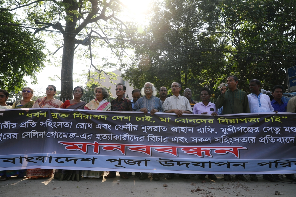 People make a human chain to demand justice for an 18 year old woman who was killed after she was set on fire for refusing to drop a sexual harassment case against her Islamic school teacher in Dhaka, Bangladesh, on Saturday. — Reuters
