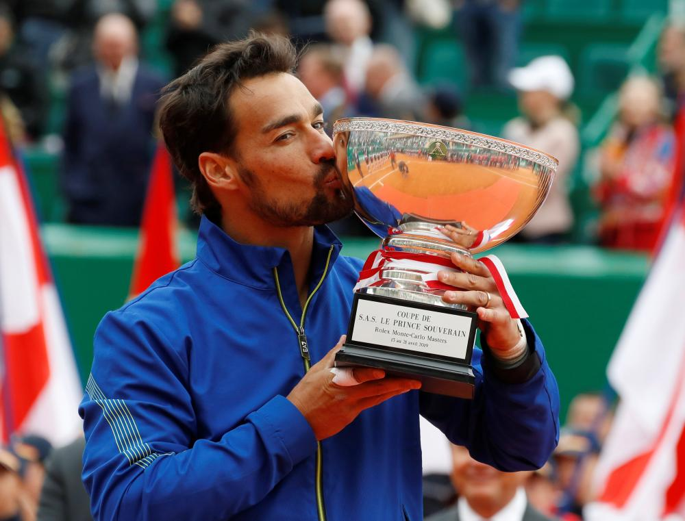Italy's Fabio Fognini celebrates with the trophy after winning the final against Serbia's Dusan Lajovic at the Monte Carlo Masters Sunday. — Reuters